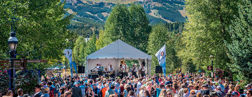 People enjoying one of many outdoor, free concerts that happen in Summit County and Breckenridge throughout the year.