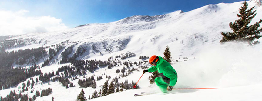 A skier begins his descent down the chutes at Breckenridge Ski Resort. World-class skiing at its best!