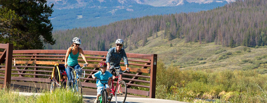 A family enjoys a bicycle ride through the aspen groves near Breckenridge, Colorado.