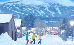 Skiers cross Main Street in Breckenridge after a mountain snow storm dropped a foot of new powder.